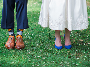 Ashley & Josh show their decorative socks and beautiful bridal shoes in Ann Arbor