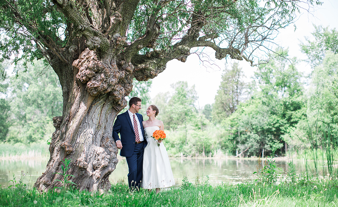 Ashley & Josh cuddle by an old tree at the Matthaei Botanical Gardens in Ann Arbor