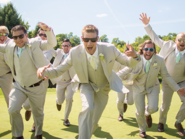 The groomsmen and groom have a laugh during their wedding photoshoot at the A Ga Ming Golf Resort in Kewadin, Michigan.