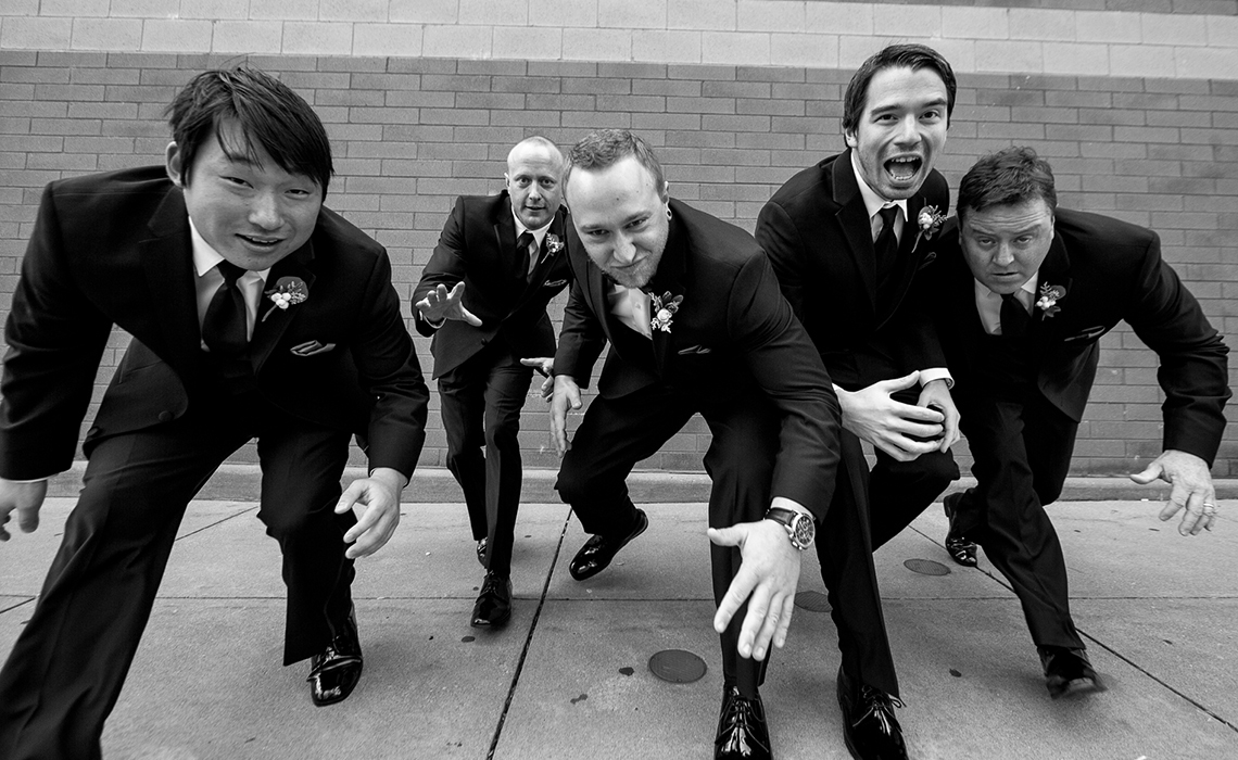 Aaron and his groomsmen have fun during their wedding day photography session.