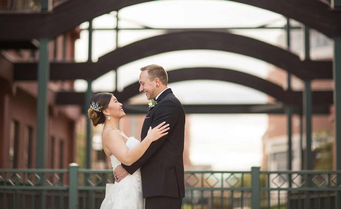 Hugging During their Downtown Kalamazoo, Michigan Wedding Day Romantic Couples Session