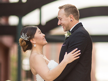 Gabby & Aaron during their downtown Kalamazoo wedding day romantic couples session.