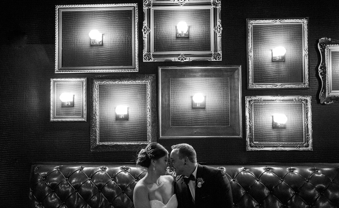 Gabby & Aaron celebrate their love in the romantic shadows of the Gatsby Bar after their Kalamazoo, Michigan wedding ceremony.