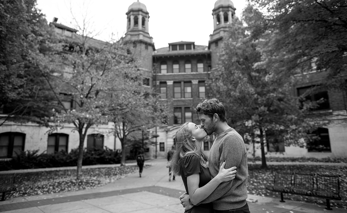 Nicole & Nicholas kiss blissfully unaware of the hustle and bustle around them on the University of Michigan College campus in Ann Arbor, Michigan